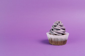 Nice muffin on violet background