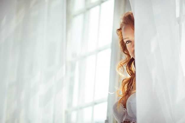 Nice portrait of beautiful and gentle bride in the morning