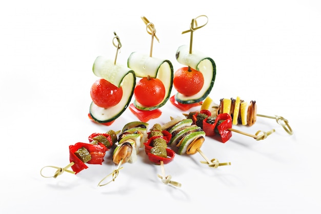 Nice set of canapes for one person with vegetables, cheese, fruits, berries, salami, seafood, meat and decoration