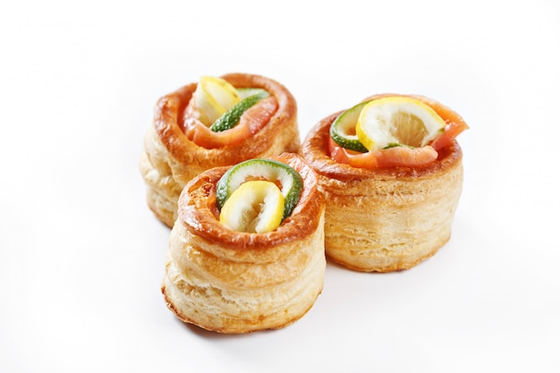 Nice set of rolled pancake canapes with lemon, lime and salmon