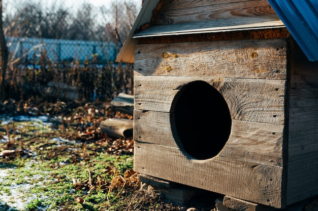 Nice solid wooden doghouse at the garden