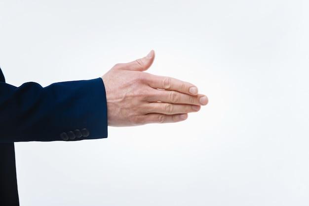 만나서 반갑습니다. 첫 번째 회의에서 좋은 긍정적 인 친절한 사업가가 당신에게주는 남성 손의 닫습니다