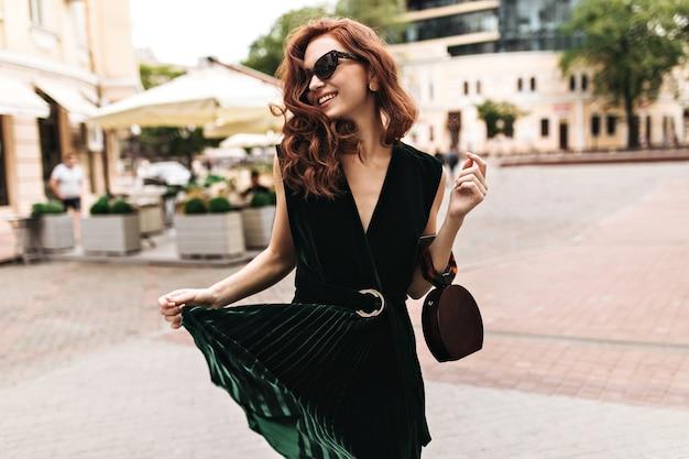 Nice woman in good mood walking through city