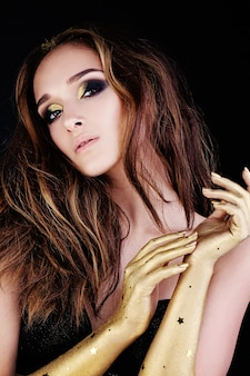 Nice woman with long brown hair and golden hands