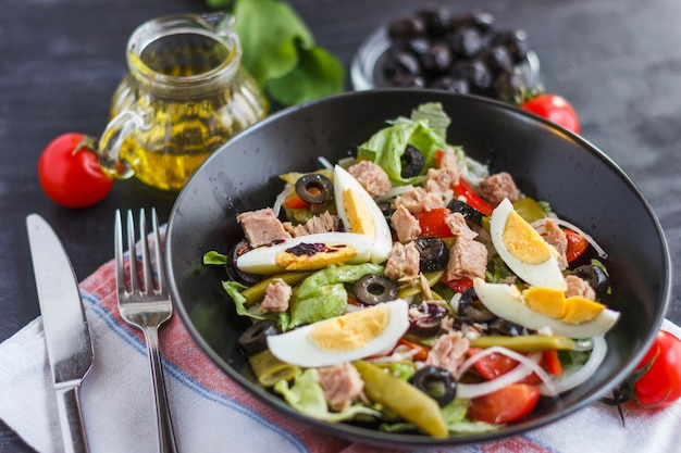 Nicoise salad with tuna, green beans, basil and fresh vegetables