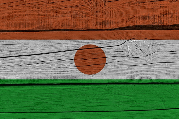 Niger flag painted on old wood plank