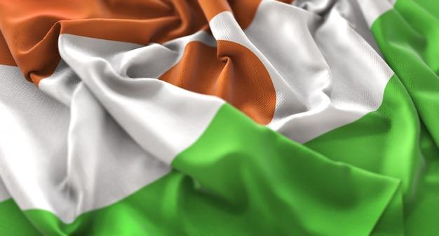 Niger flag ruffled beautifully waving macro close-up shot