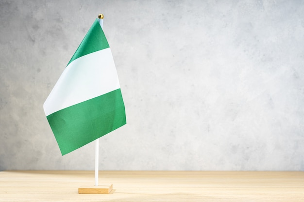 Nigeria table flag on white textured wall. copy space for text, designs or drawings