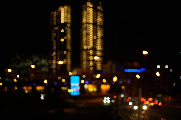 Night bokeh light in big city. defocused illuminated skyscrappers and river of city downtown. abstract blur defocused background.