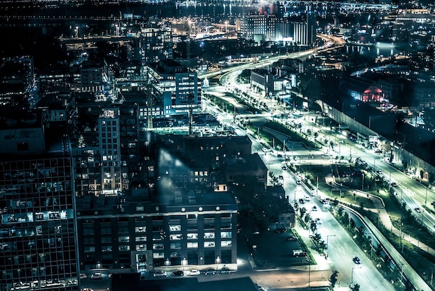 Night buildings with lights and cars at night in montreal