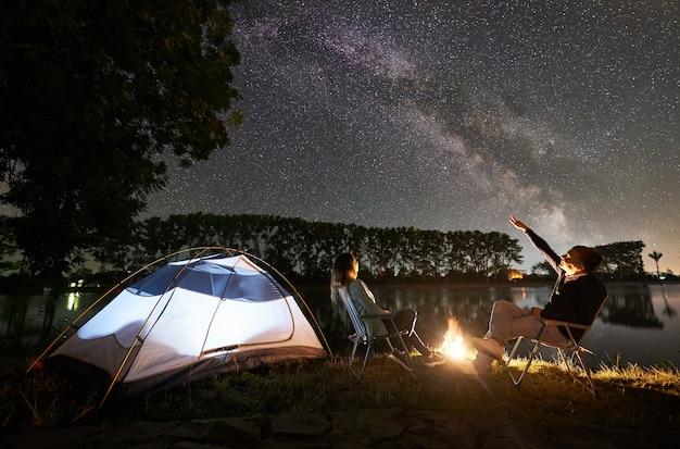 Night camping on lake shore