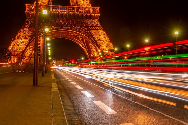 Night car traffic under the eiffel tower