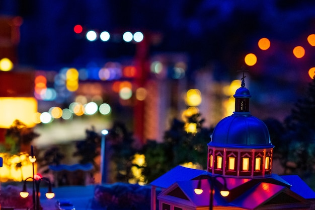Night city lights soft focus, miniature