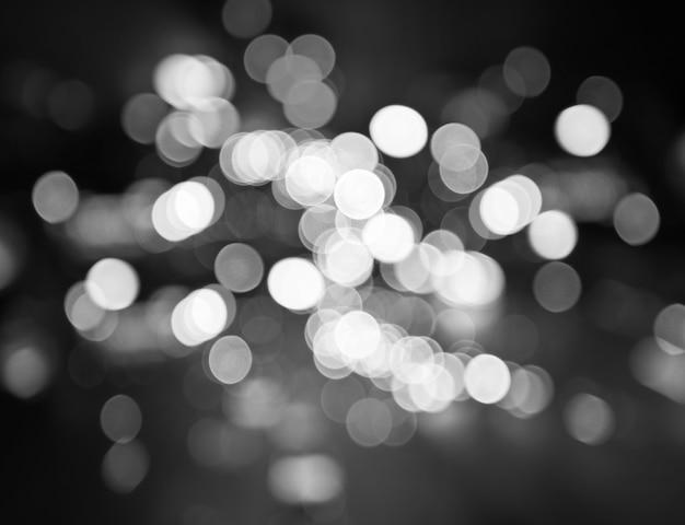 Night city street lights bokeh background, black and white