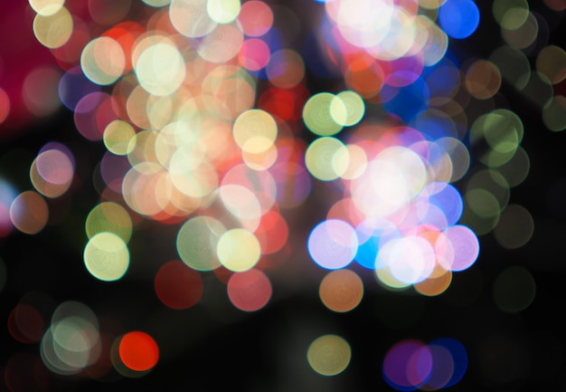 Night city street lights colorful bokeh background, darkness concept