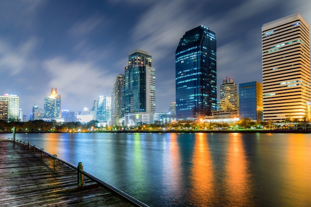 Night cityscape of bangkok thailand with colorful of light reflection in the lake
