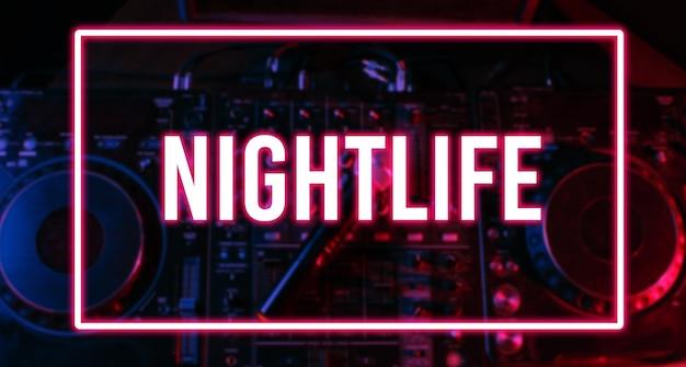 Night club, nightlife concept. disco. microphone on dj remote. neon red blue light