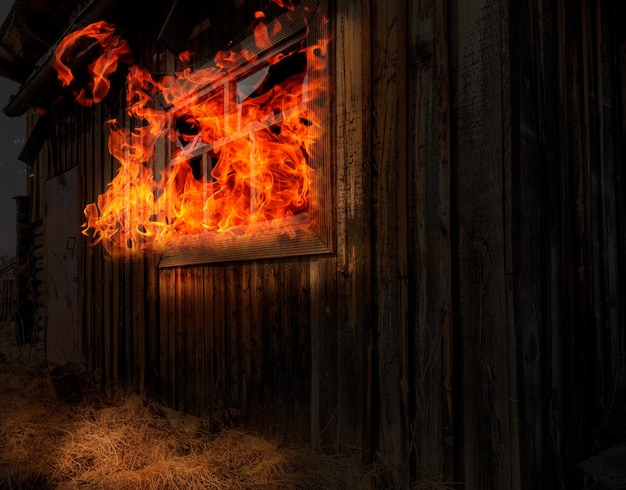 Night fire in a wooden house. flames of fire from a window in a wooden house. house on fire. nightmare