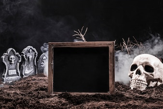 Night graveyard with skull and black sign
