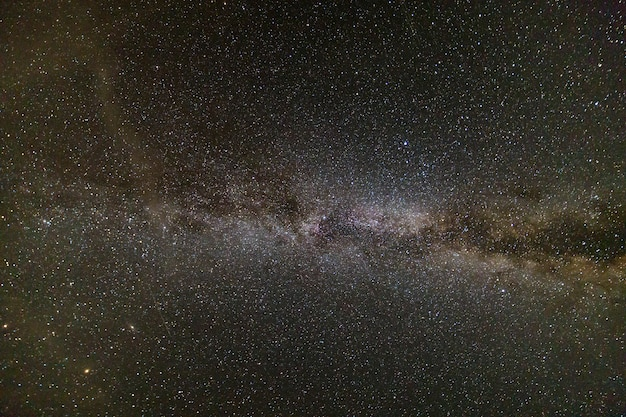 Night landscape of milkyway with stars covered sky .