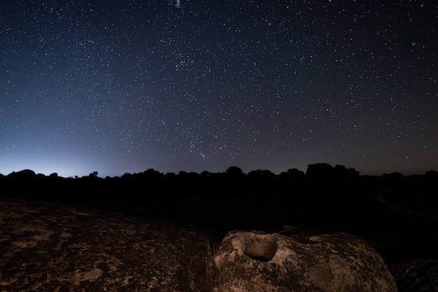 Night landscape with ancient grave in the barruecos natural area. spain.