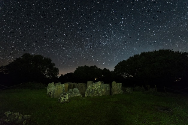 Night landscape with ancient prehistoric dolmen. dolmen of the great oak.
