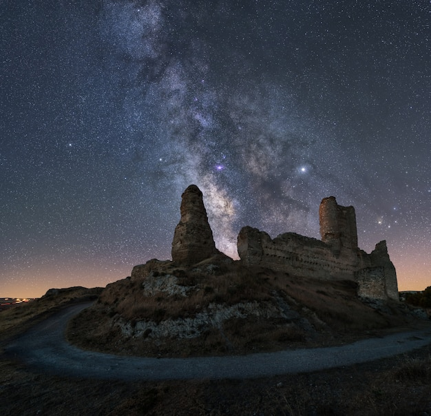 Night landscape with the milky way over an old castle