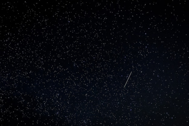 Night landscape with perseid meteor.