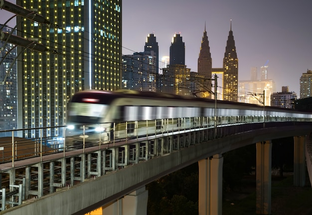At night, the light rail train shuttles through the city.