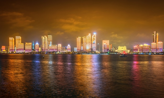 At night, the lighting show is on the city skyline, qingdao, china