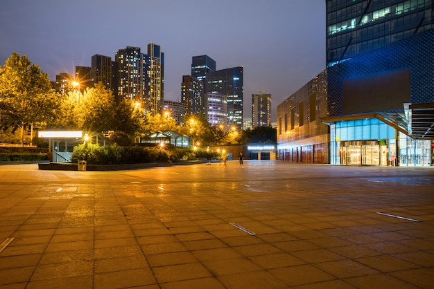 At night, modern city buildings and plazas are in the financial center of qingdao, china.