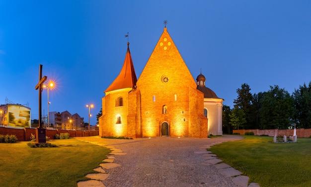 Night panorama of church of saint john of jerusalem outside the walls in poznan, poland