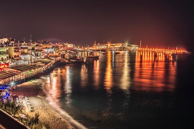 Night panorama of the embankment in the city of chersonissos, crete, greece
