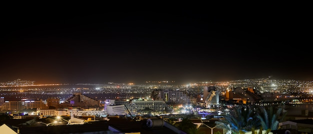 Night panoramic view on beach of the red sea in eilat famous resort and recreation town in israel