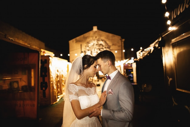 Night photosession of wedding couple in the old town of krakow,