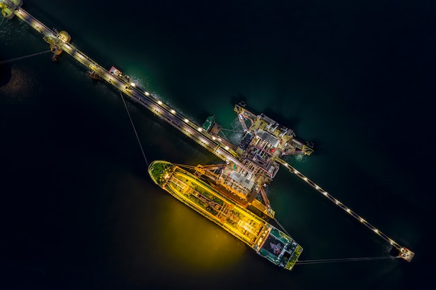 Night shot oil tanker shipping loading in oil station import and export  logistics transportation business top view
