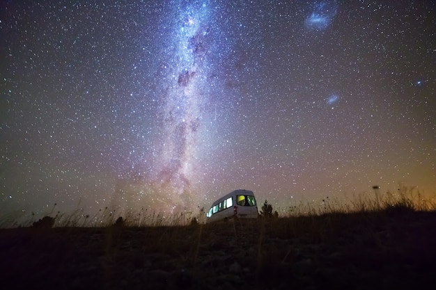 Night sky with milky way over campervan, south island new zealand