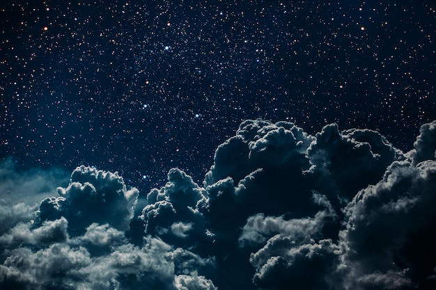 Night sky with stars and moon and clouds. Premium Photo