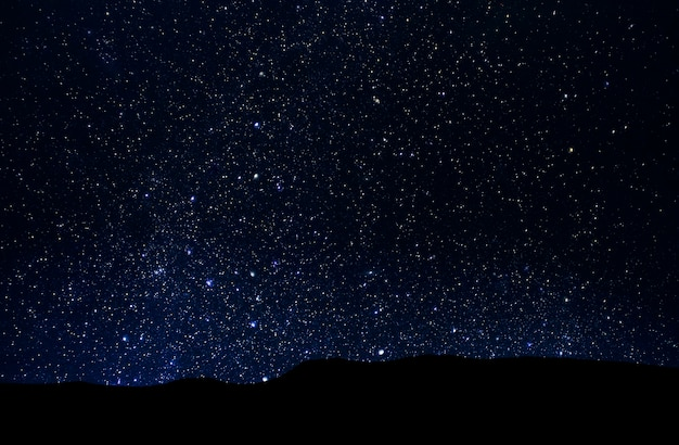 Night starry sky, deep space over valley