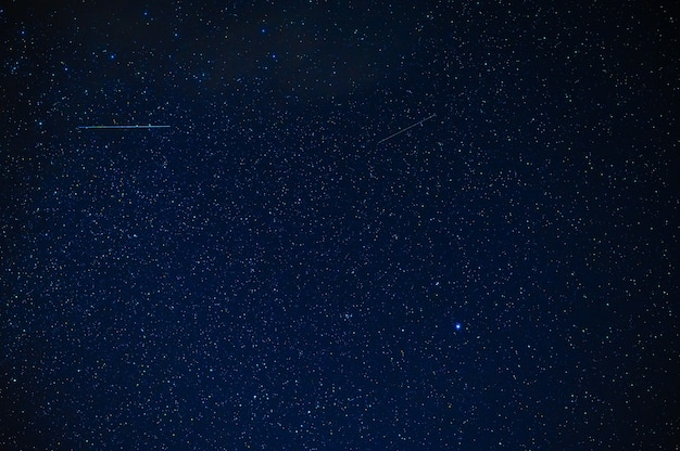 Night starry sky with stars, constellations, nebulae and galaxies at night. abstract blue background