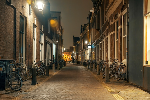Night street with parked bicycles