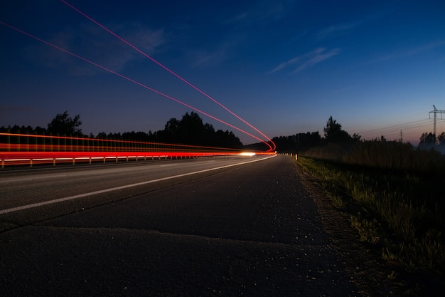 Night track with blurred lights from the headlights of cars.long exposure time.
