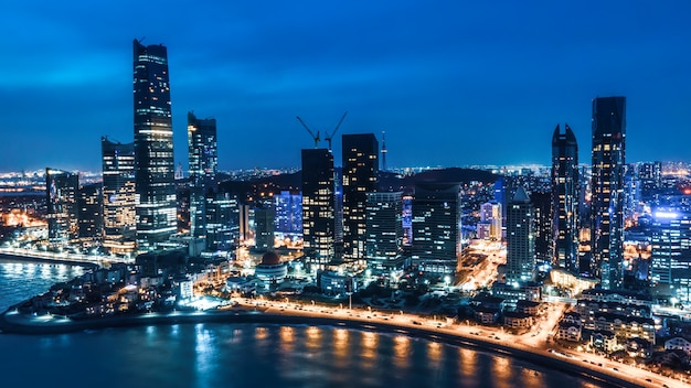 Night view of modern city buildings in qingdao, china
