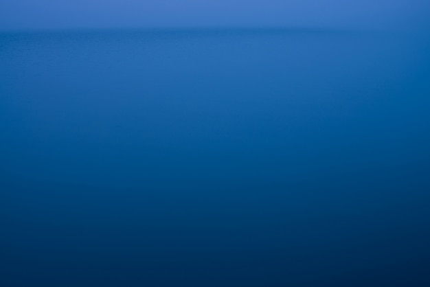 Night water surface in fog.