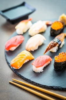 Nigiri sushi set with salmon tuna shrimp prawn eel shell