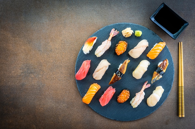 Nigiri sushi set with salmon tuna shrimp prawn eel shell