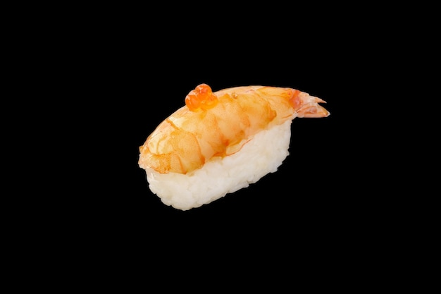 Nigiri sushi tiger shrimp, red caviar isolated
