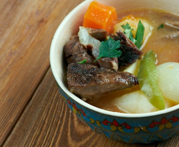 Nikujaga -japanese dish of meat, potatoes and onion stewed in sweetened soy sauce Premium Photo