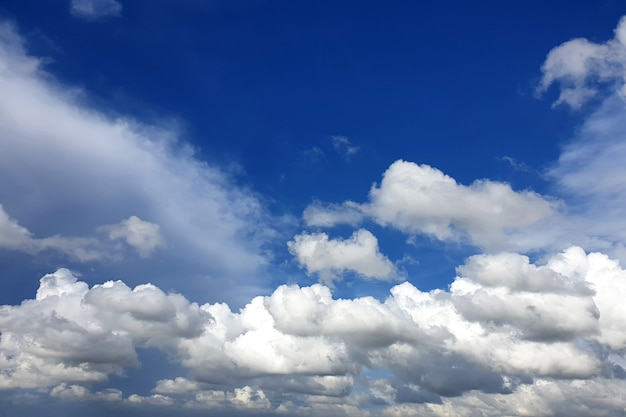 Nimbus clouds in the blue sky over the city