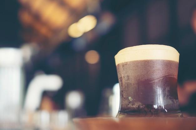 Nitro cold brew coffee in cafe